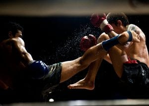 muay thai fighters high kick