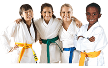 kids in karate uniform smiling at camera
