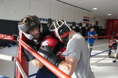 men fighting in ring precision mma