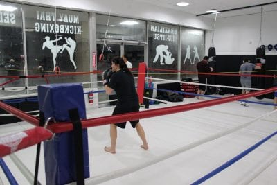 woman in boxing ring practicing sparring