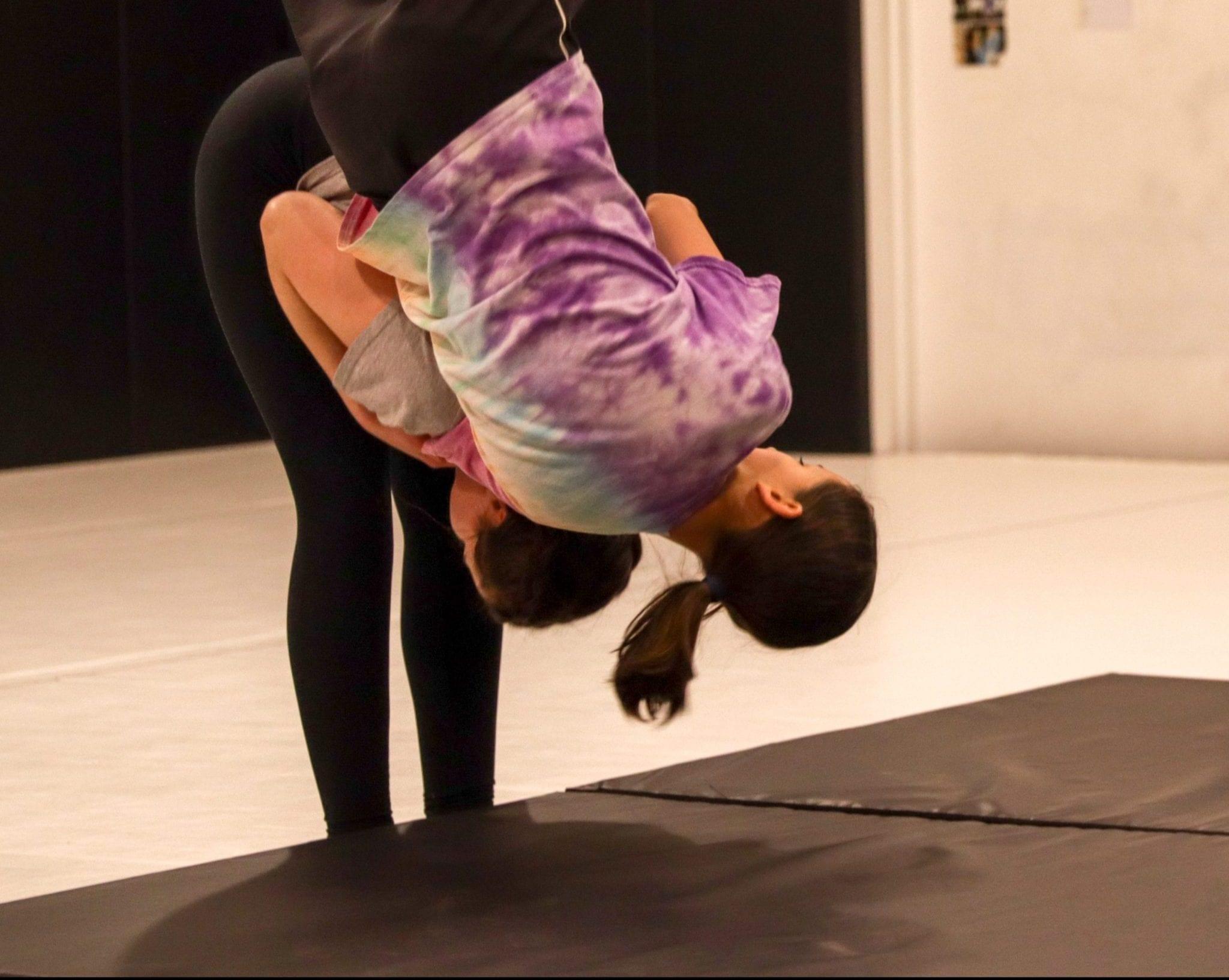 women being thrown on mat women classes