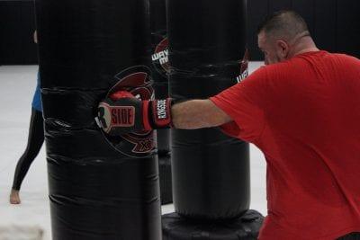 man punching a heavy bag
