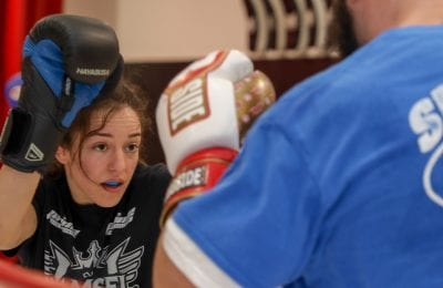 girl with hands up sparring