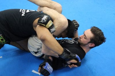 two men sparring in octagon precision