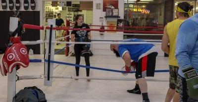 girl smiling in boxing ring