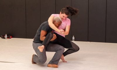 two women learning grappling moves