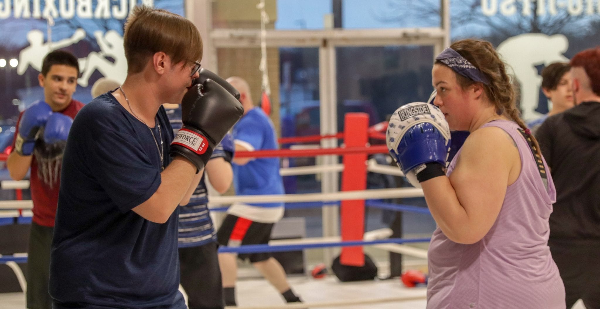 two young adults sparring