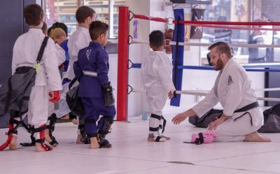 brian helping kids put on equipment