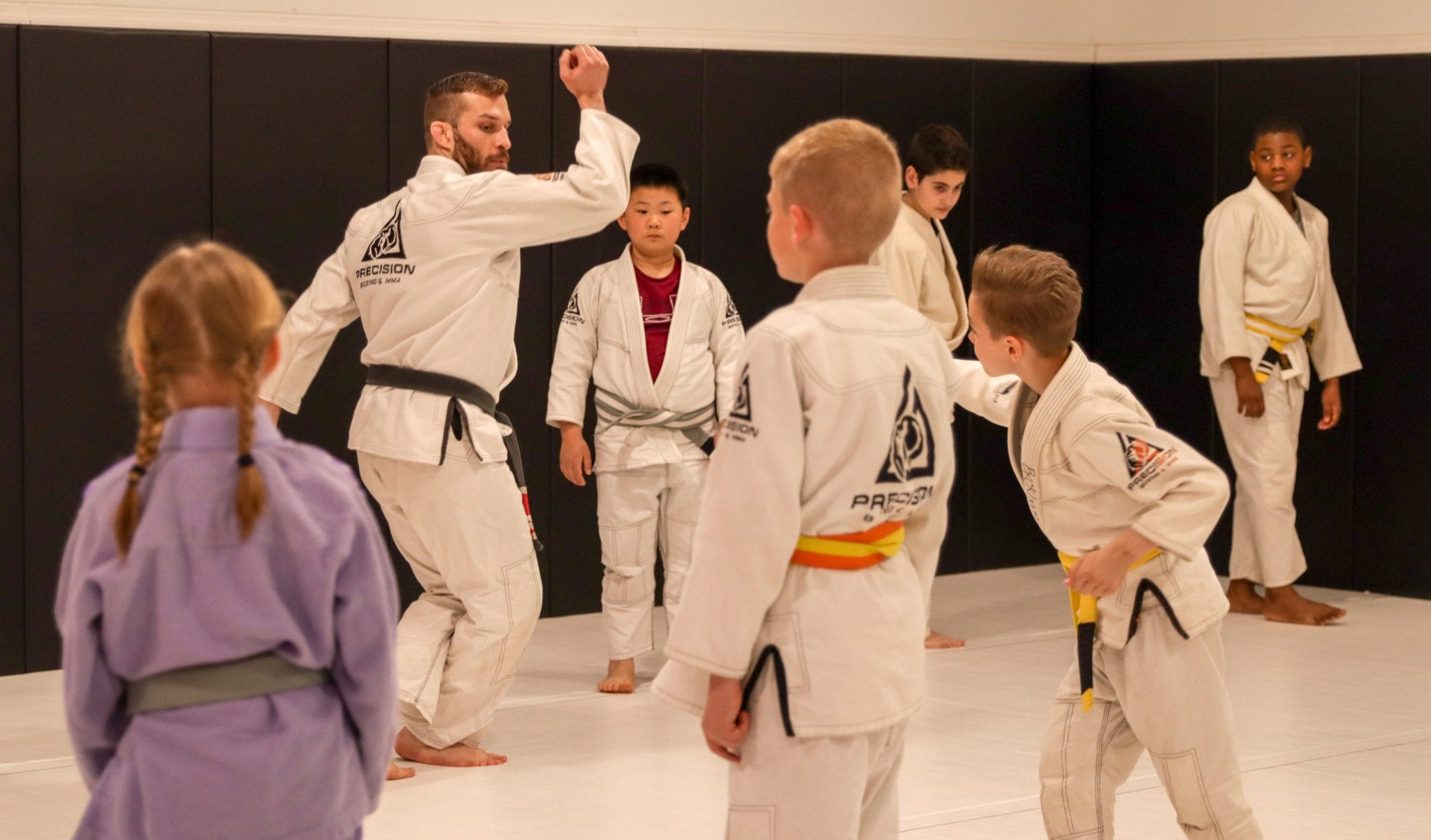 brian teaching a bjj move during kids class