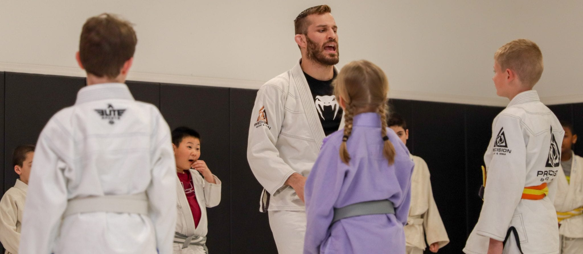 brian teaching kids classes at precision mma