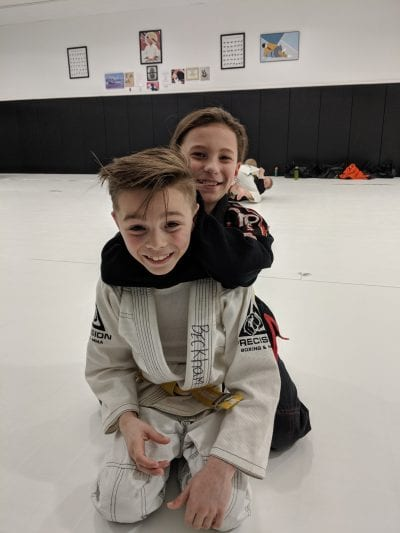 two kids smiling precision karate